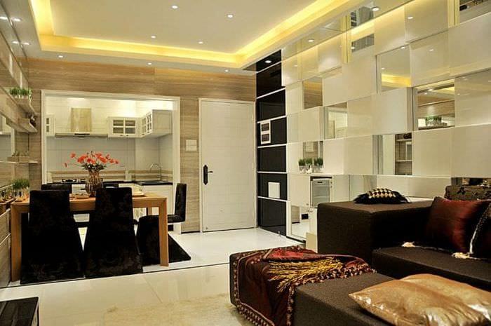 Большая и просторная комната с совмещенными кухней столовой и гостиной