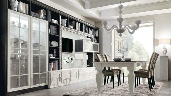 Дизайн большой и светлой комнаты с тумбой под телевизор
