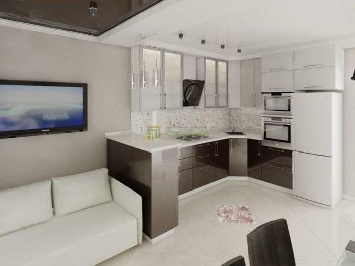 Фото дизайна модной кухни-гостиной в белом цвете