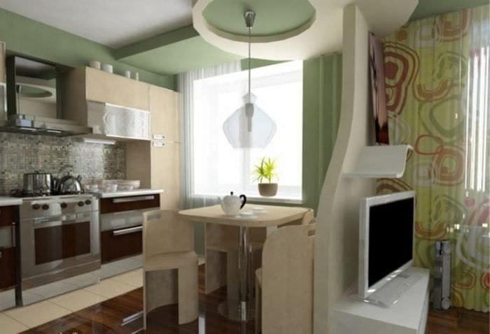 Небольшая многофункциональная кухня-гостиная с встроенной техникой