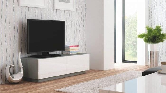Необычная светлая тумба под большой телевизор