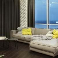 темный угловой диван в интерьере коридора картинка