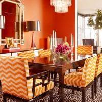 приятный терракотовый цвет в интерьере кухни фото