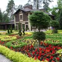 шикарный ландшафтный дизайн сада в английском стиле с цветами фото