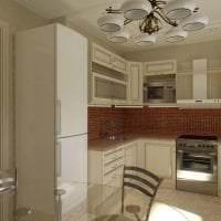 небольшой холодильник в дизайне кухни в бежевом цвете фото