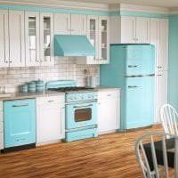 небольшой холодильник в дизайне кухни в ярком цвете фото