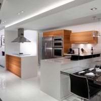 темный интерьер элитной кухни в стиле модерн фото