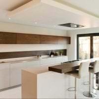 темный дизайн элитной кухни в стиле арт деко картинка