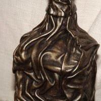 вариант шикарного декорирования бутылок из кожи своими руками фото