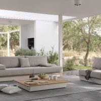 идея современного декора квартиры с диваном фото