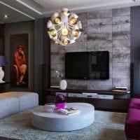 идея современного декора комнаты с диваном картинка