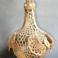 идея оригинального декорирования стеклянных бутылок солью фото