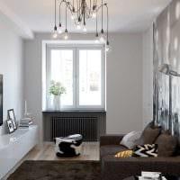 идея функционального интерьера гостиной комнаты 17 кв.метров фото