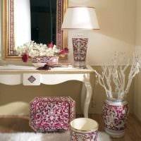 идея красивого дизайна вазы с декоративными ветками фото