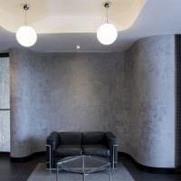 вариант оригинальной декоративной штукатурки в интерьере гостиной под бетон фото