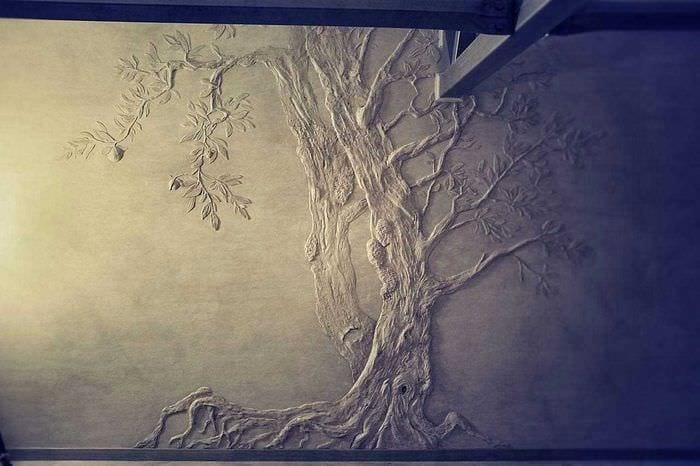 идея оригинального интерьера комнаты с декоративным рисунком на стене