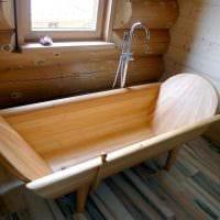 идея необычного стиля ванной в деревянном доме фото