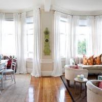 пример необычного дизайна гостиной с эркером фото