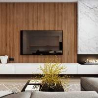 вариант светлого дизайна гостиной с камином картинка