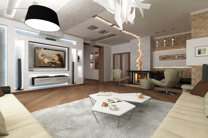 вариант красивого интерьера гостиной с камином