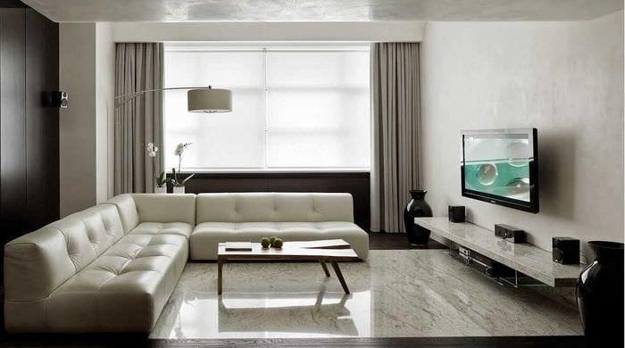 вариант красивого интерьера гостиной в стиле минимализм