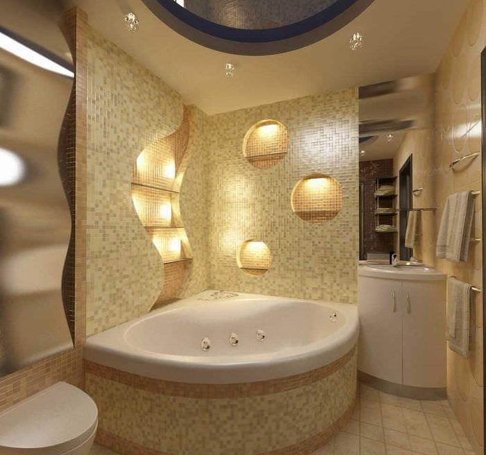 вариант красивого интерьера ванной с угловой ванной
