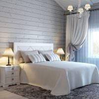 вариант современного интерьера спальни в белом цвете фото