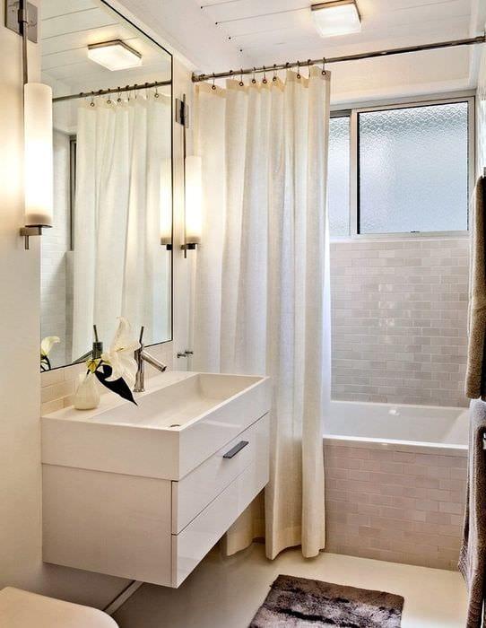 вариант светлого дизайна ванной комнаты в бежевом цвете