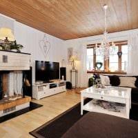 пример необычного интерьера гостиной комнаты с камином картинка