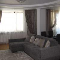 вариант необычного интерьера гостиной комнаты с эркером картинка