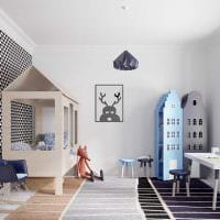 идея светлого современного интерьера детской комнаты фото