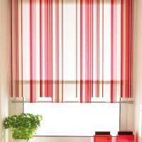 вариант красивого декора спальни с римскими шторами фото