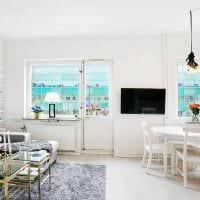 идея применения светлого ламината в красивом стиле квартиры фото