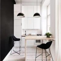 дизайн малогабаритной кухни черная стена