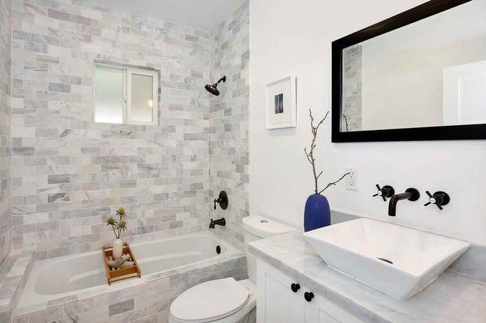 идея необычного стиля укладки плитки в ванной комнате