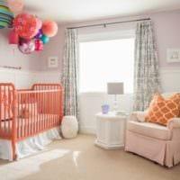 детская комната для новорожденного оранжевая кровать