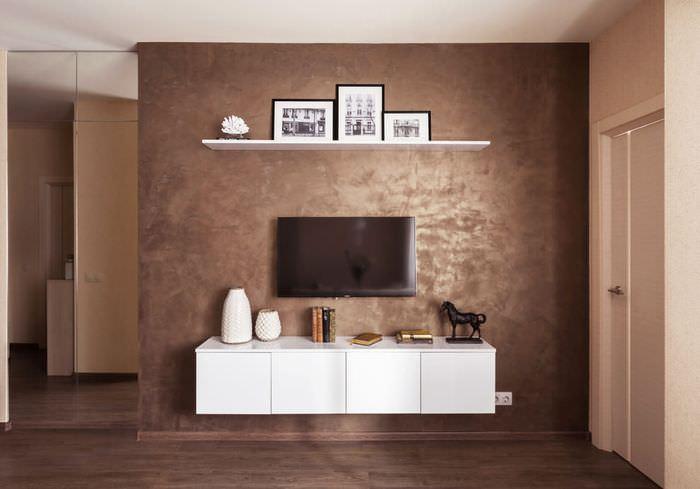 Декоративное оформление стены фактурной шпаклевкой