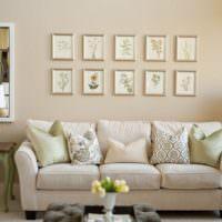 Стена над диваном в гостиной с картинами