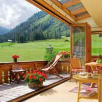 Сдвижные окна в интерьере дачной веранды
