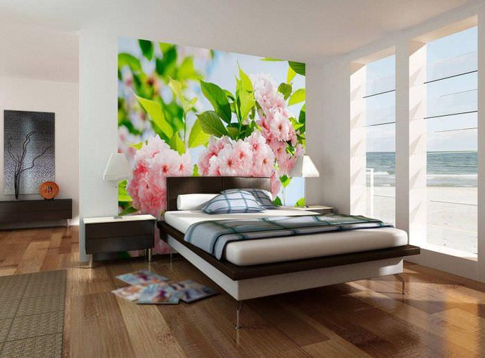 Фотообои с яркими цветами и листьями в дизайне спальни