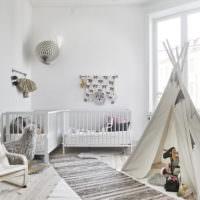 Комната в светлых тонах для двух новорожденных