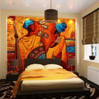 Фотообои на стене спальни и оранжевое покрывало на кровати