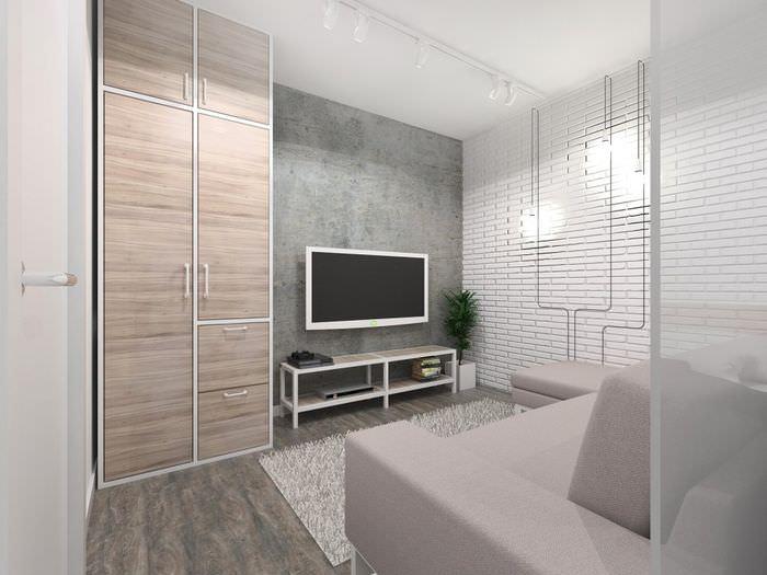 Белая кирпичная стена в дизайне однокомнатной квартиры