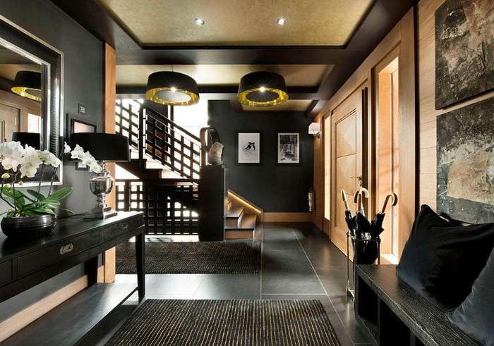 Отделка гостиной в черном цвете в квартире мужчины
