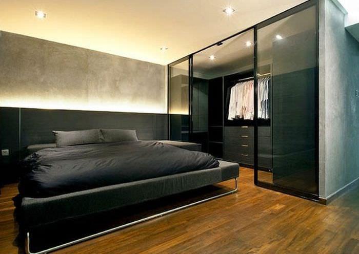 Дизайн строгой мужской спальни в черных тонах
