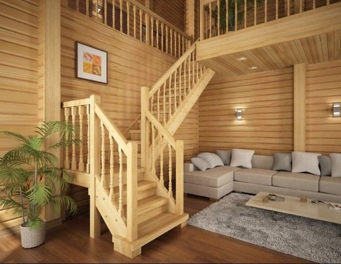 Деревянная лестница из сосны в интерьере гостиной частного дома