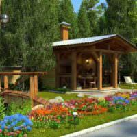 Цветущая клумба перед деревянной беседкой с камином
