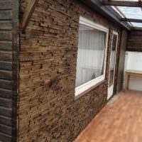 Отделка деревом наружной стены жилого дома