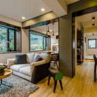 Зонирование однокомнатной квартиры диваном