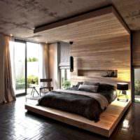 Древесина и бетон в интерьере спальни загородного дома